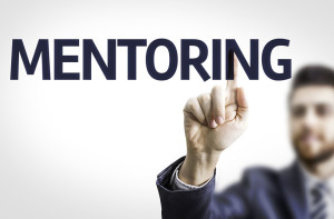 Business man pointing the text: Mentoring
